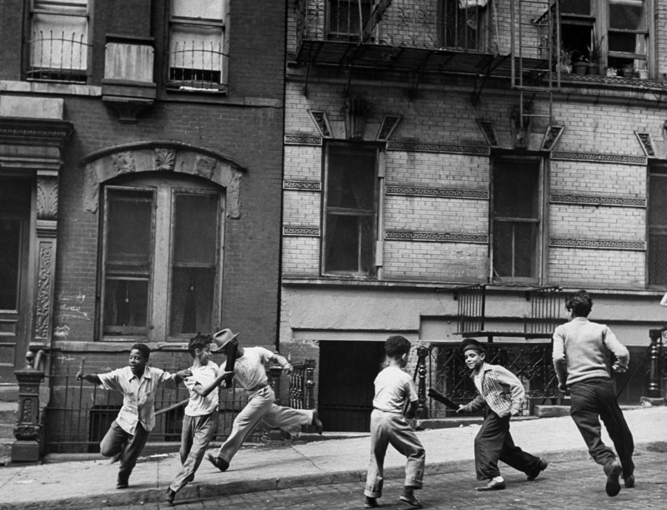 08 Young boys with play a street game in Spanish Harlem in January 1947